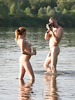 Wild couple making a nude beach video