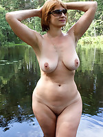 Busty mature ladies in a water under the sun - Chubby Naturists