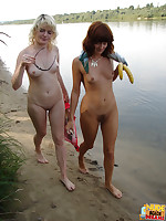 After having lesbian sex with fingers and a banana these two cool off in the ocean