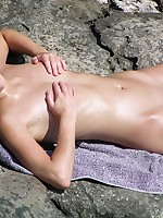 Sexy blonde babe sunbathing totally naked